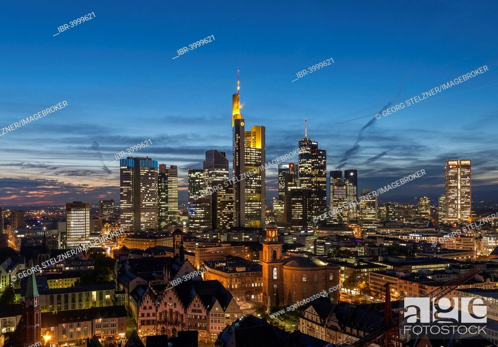 Stock Photo: Views of the city skyline at dusk and lit skyscrapers, city centre, Frankfurt am Main, Hesse, Germany.