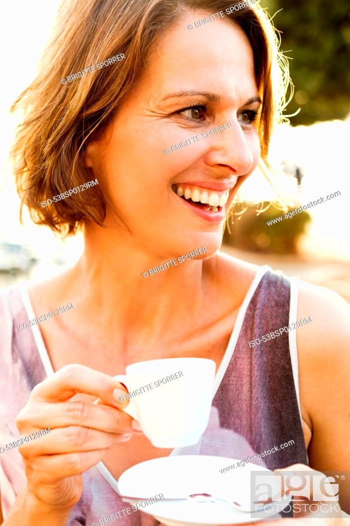 Stock Photo: Woman having espresso outdoors.