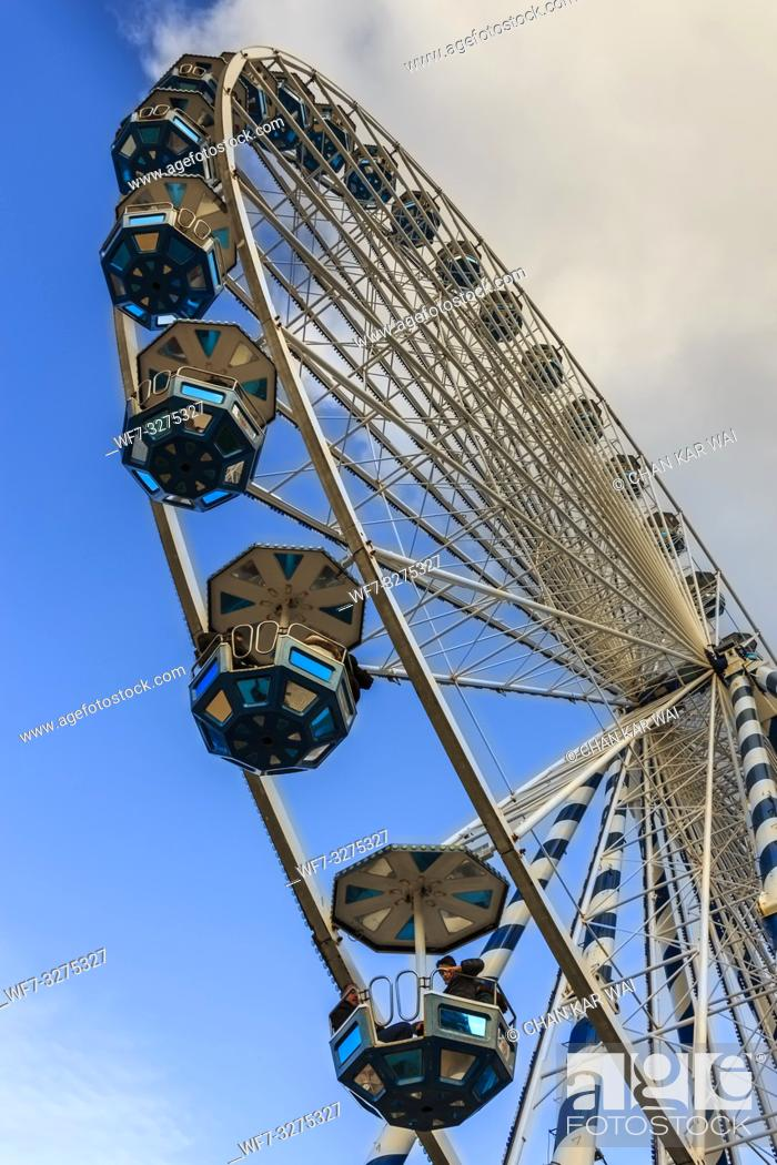 Stock Photo: San Sebastian, Spain - Jan 2019: Bottom up view of the ferris wheel situated at the end of La Concha beach promenade heading to the old town of San Sebastian.