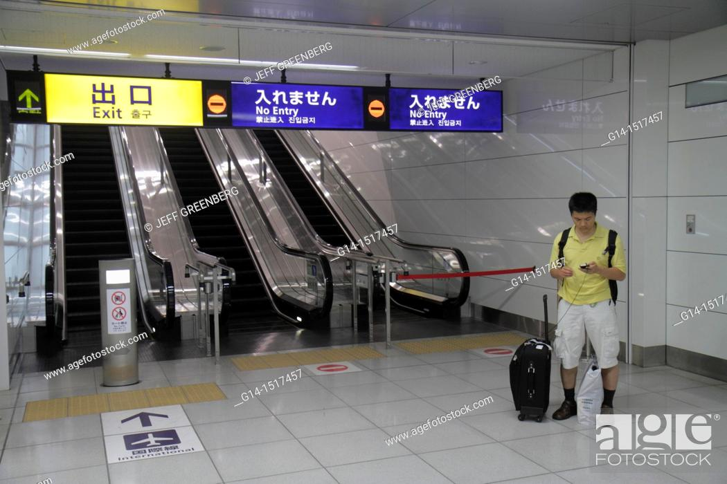 Japan, Tokyo, Haneda Airport, escalator, English and