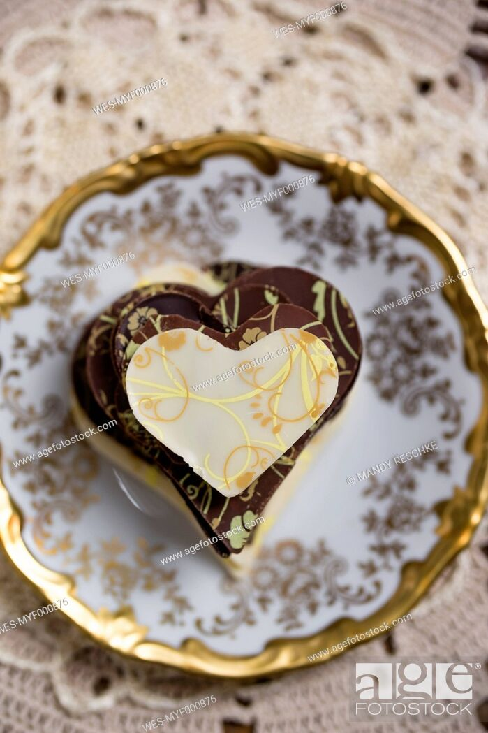 Stock Photo: Stack of homemade chocolate hearts on plate.