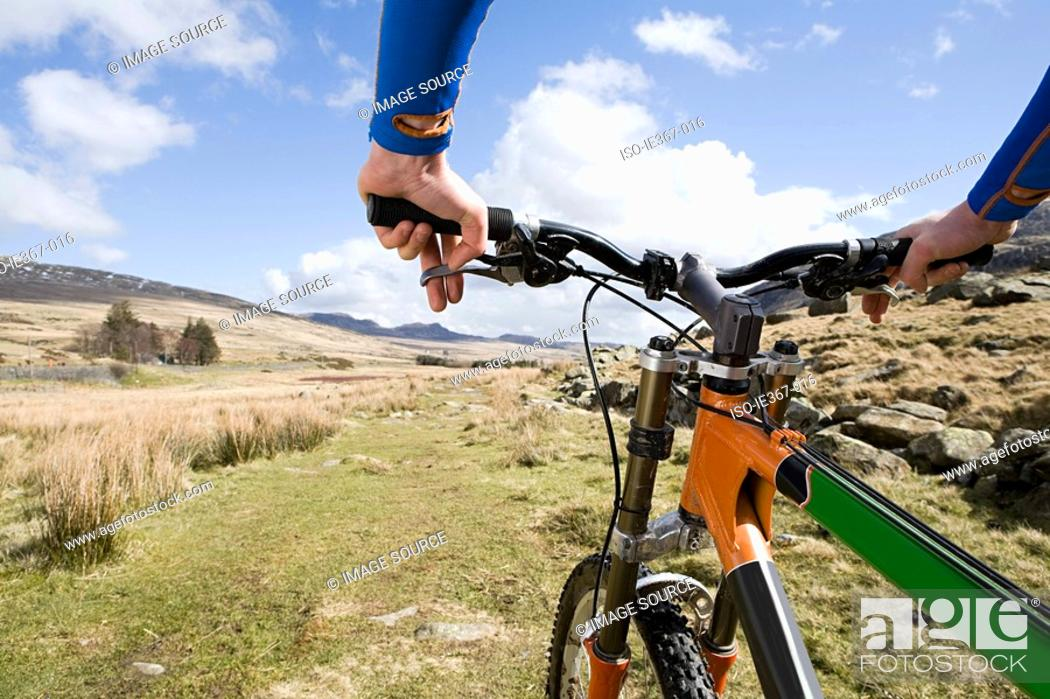 Stock Photo: A man cycling.