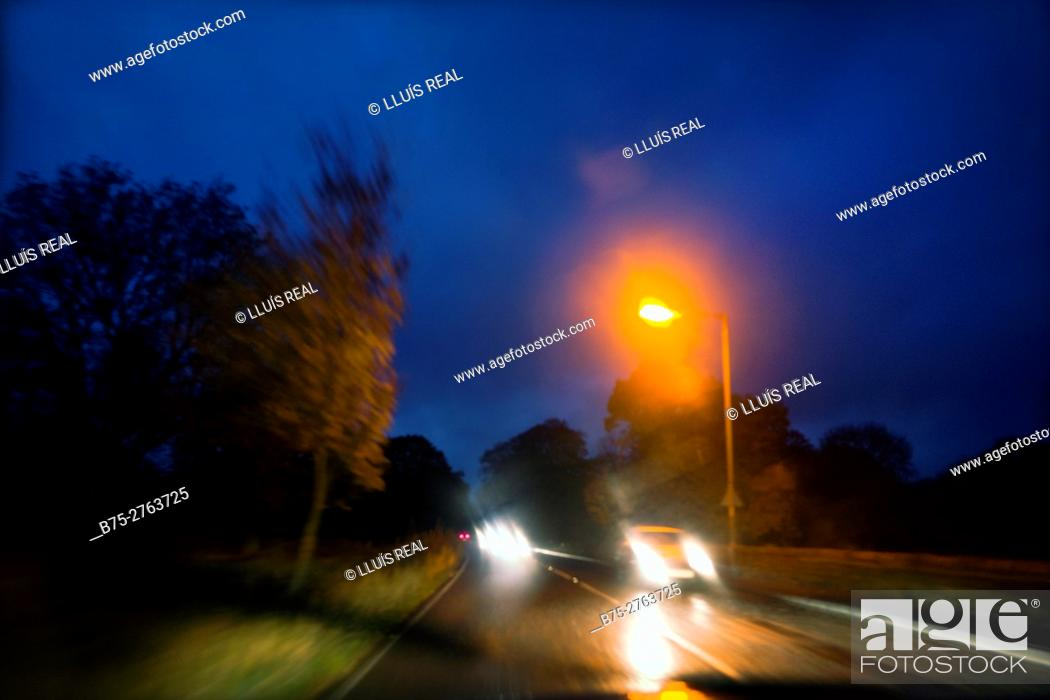 Stock Photo: Traffic on the road from Skipton to Grassington in the evening, headlights, North Yorkshire, England.