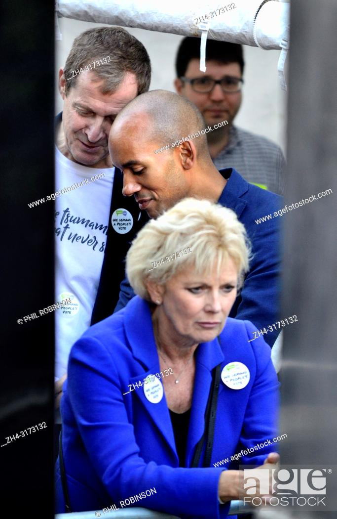 Stock Photo: Alastair Campbell talking to Chuka Umunna MP behind Anna Soubry MP (Con: Broxtowe) backstage before speaking at the People's Vote March in support of a second.