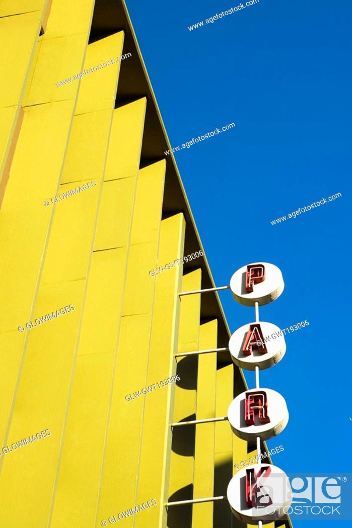 Stock Photo: Low angle view of a neon sign at a building, Honolulu, Oahu, Hawaii Islands, USA.