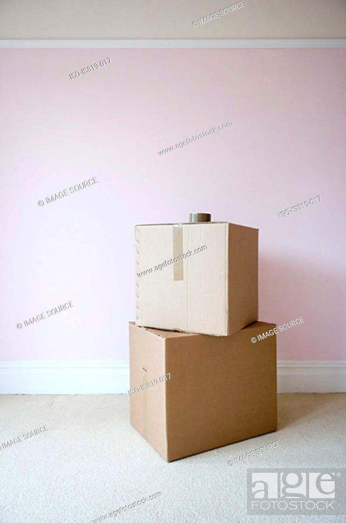 Stock Photo: Cardboard boxes in sparse room.