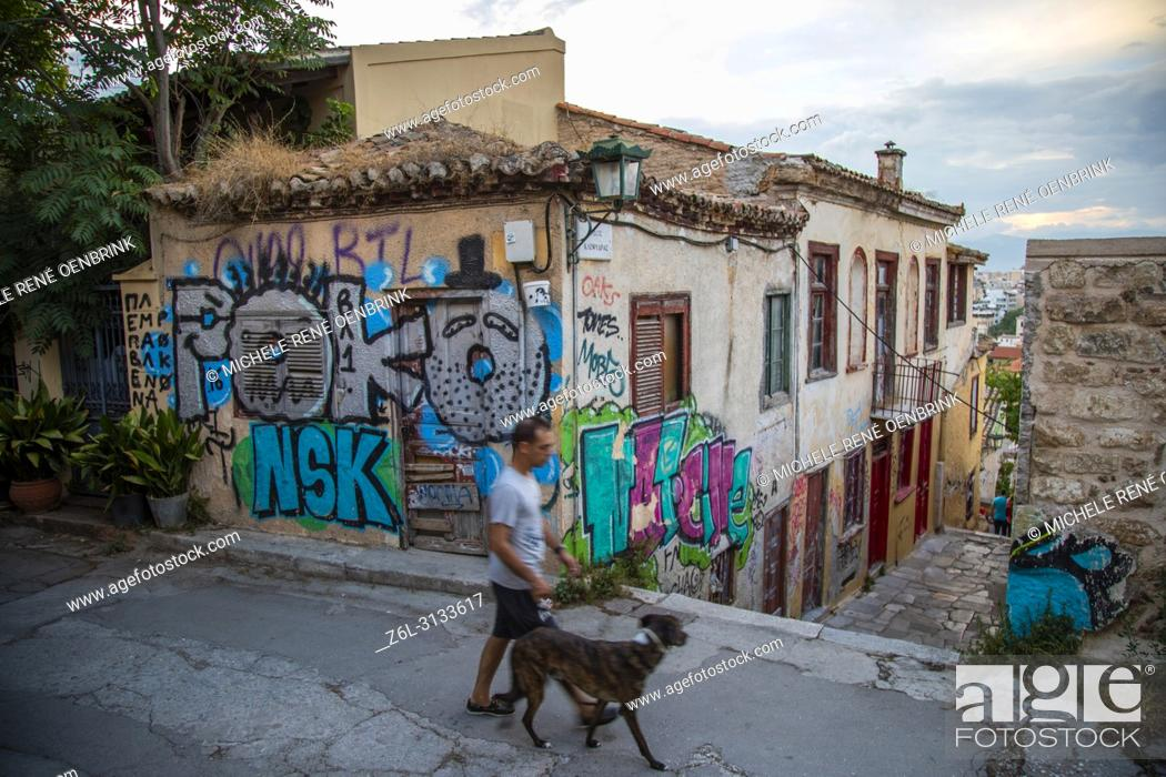 Stock Photo: Europe, Greece, Attica Athens, Anafiotika Plaka , Graffiti On Wall At Street The part of old town of Athens called Anafiotika is built right below the Acropolis.