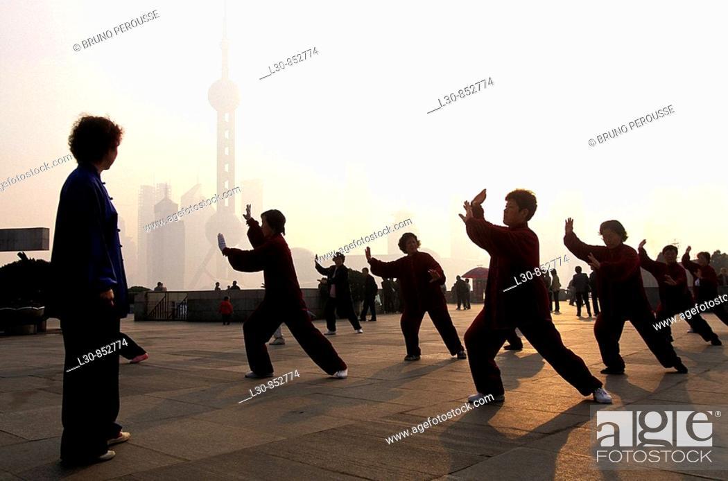 Stock Photo: Early morning tai chi exercises on the Bund, Shanghai, China.