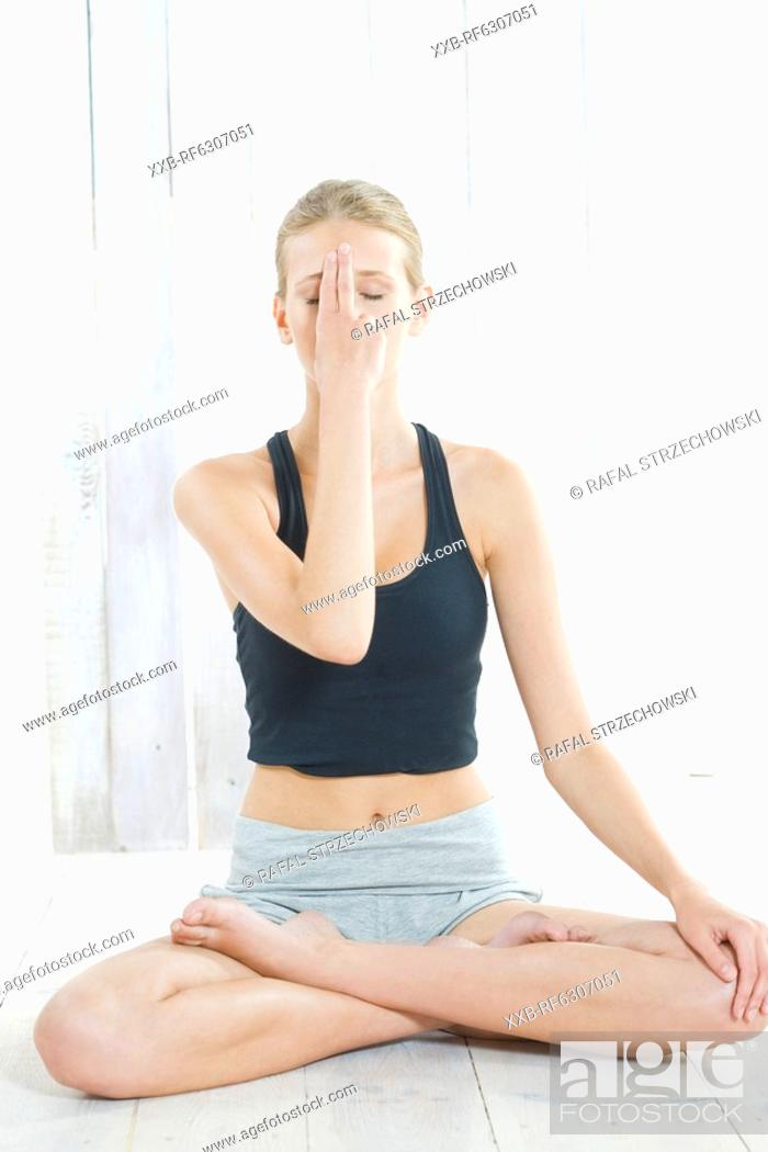 Stock Photo: woman meditating.