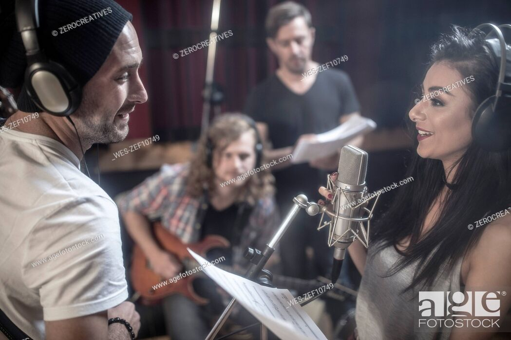 Stock Photo: Band rehearsal in recording studio.