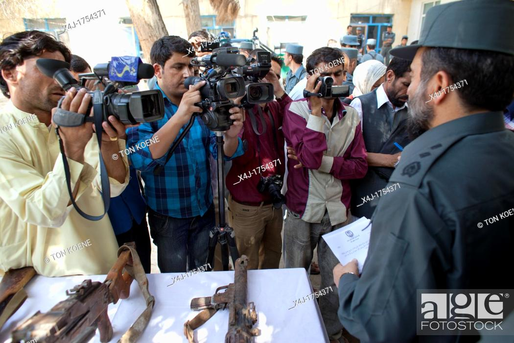 Stock Photo: afghan police in Kunduz give a press conference about preventing a bomb explosion.