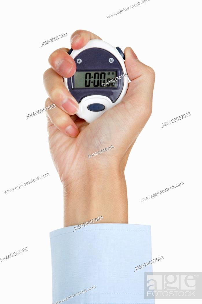 Stock Photo: Human hand holding a stopwatch.