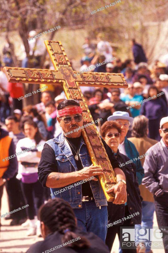 Stock Photo: pilgrim carrying cross.