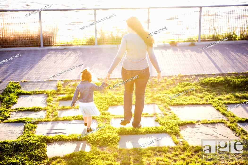 Stock Photo: Young Mother and two year old daughter spending time together in the park.