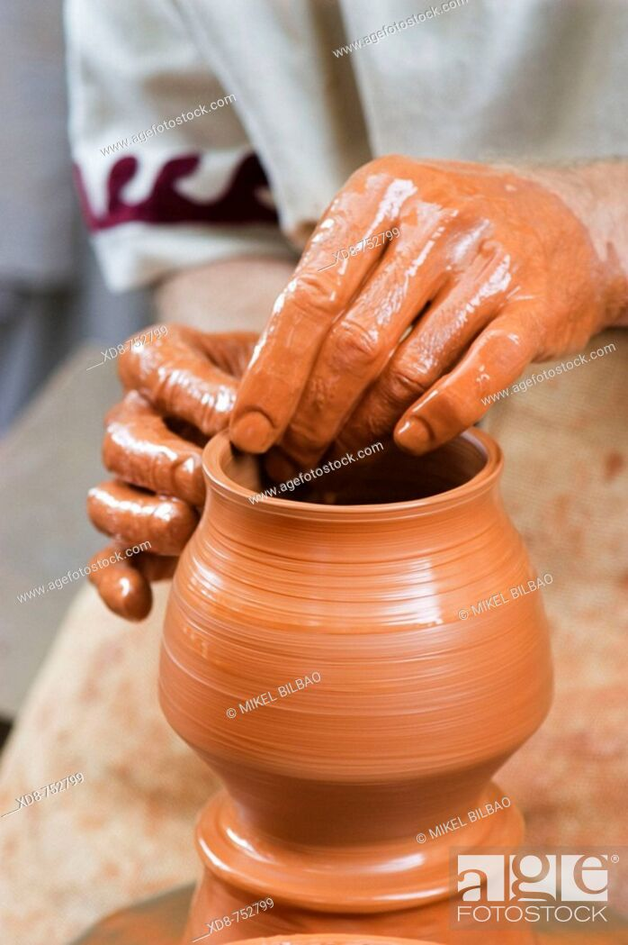 Photo de stock: Potter working in a clay pot.