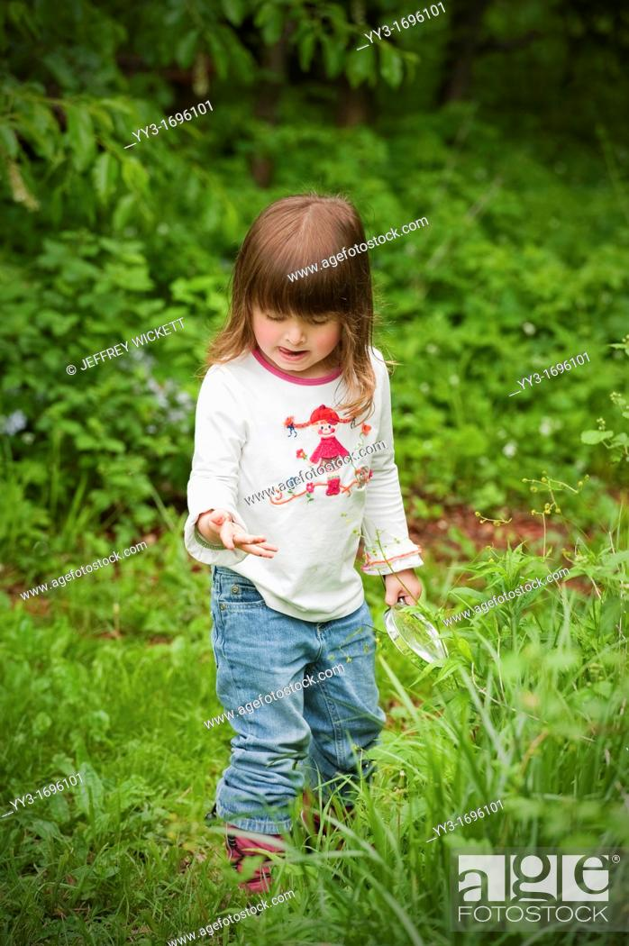 Stock Photo: Three year old child exploring nature in Sheridan, Indiana, USA.