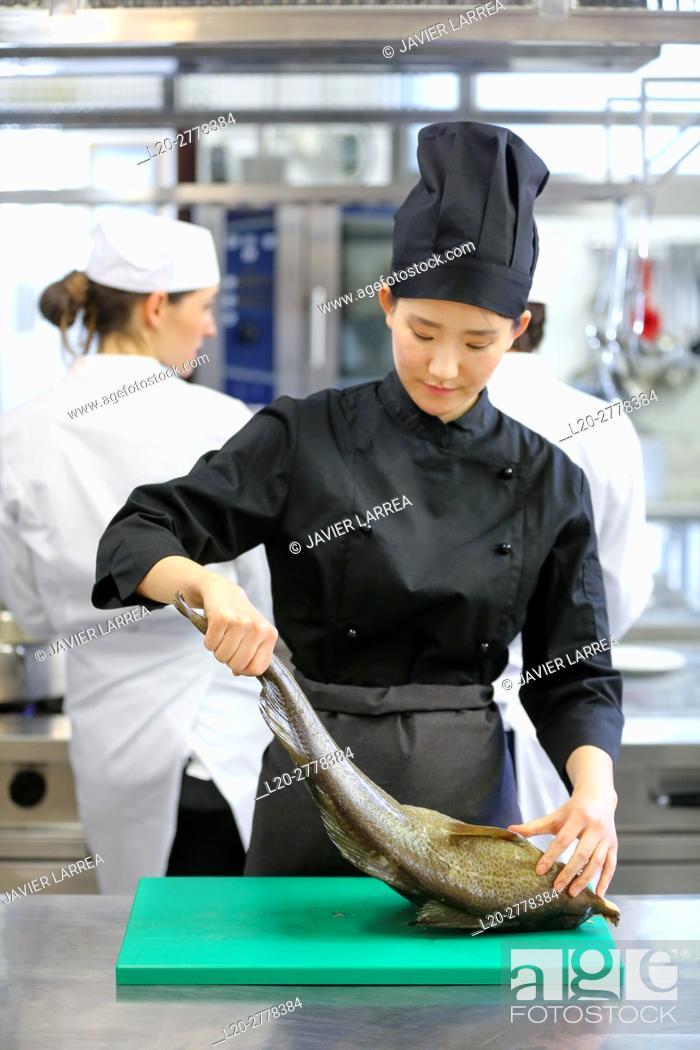 Stock Photo: Chef cutting cod, Cook in cooking school, Cuisine School, Donostia, San Sebastian, Gipuzkoa, Basque Country, Spain, Europe.