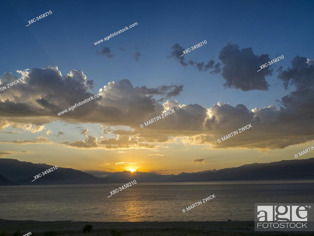 Stock Photo: Landscape at Toktogul Reservoir and river Naryn in the Tien Shan or heavenly mountains. Energy is one of the most important export commodities.