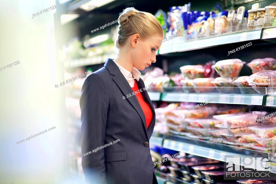 Stock Photo: Woman shopping in a supermarket.