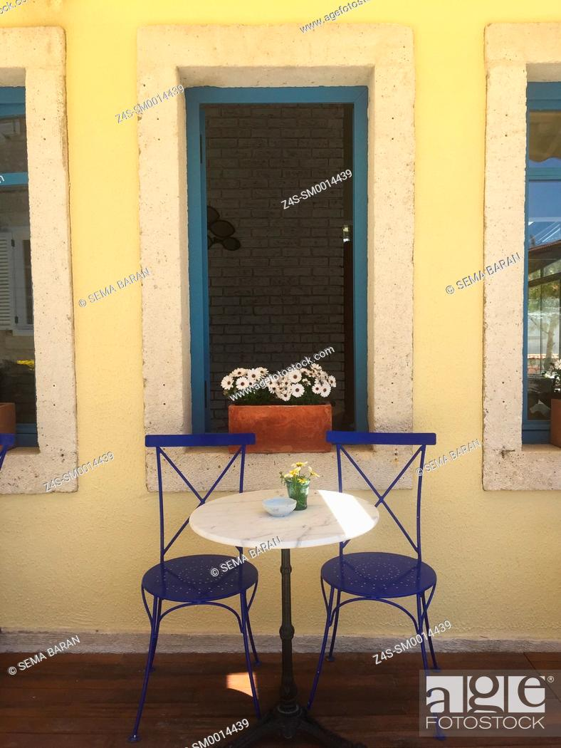 Stock Photo: Two chairs waiting for guests at the cafe in Alacati town, the historic centre of Zeytineli Koeyue, Cesme, Izmir, Aegean Coast, Turkey, Europe.