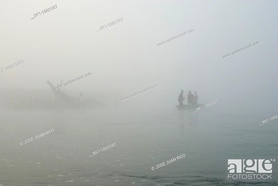 Stock Photo: Nepali canoe in a river.
