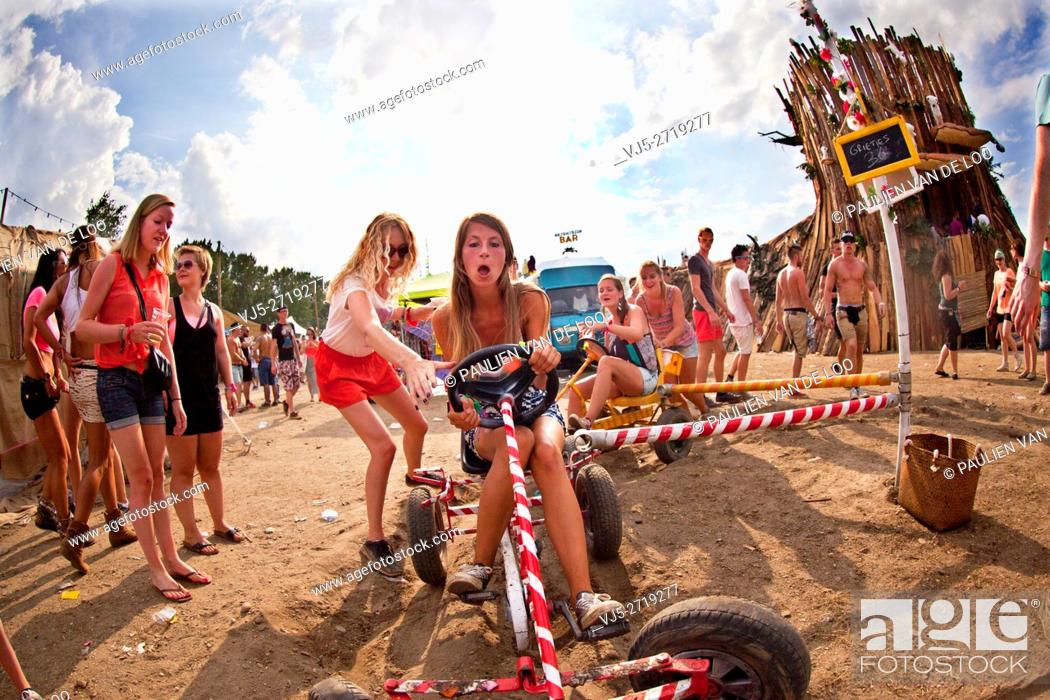 Stock Photo: Roermond, Netherlands, girls are having fun playing with toys from their childhood.