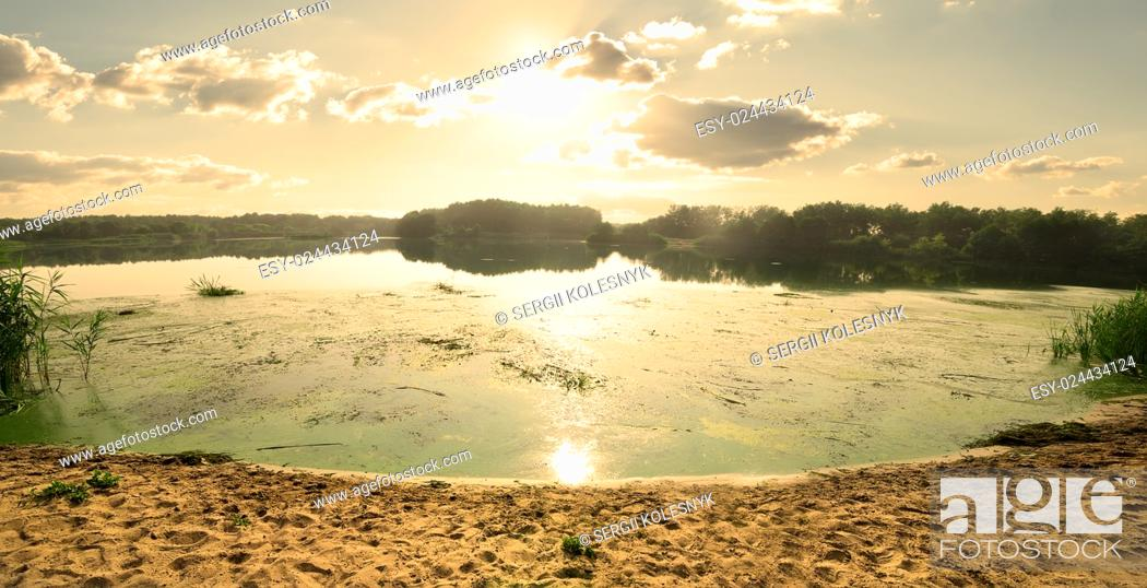 Stock Photo: Beautiful evening on a river and sandy beach.