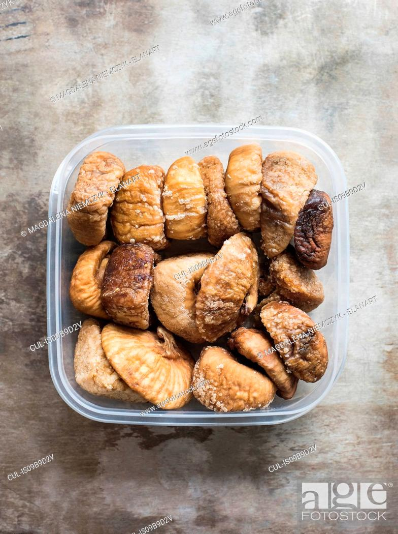 Stock Photo: Dried figs in plastic container, close-up.