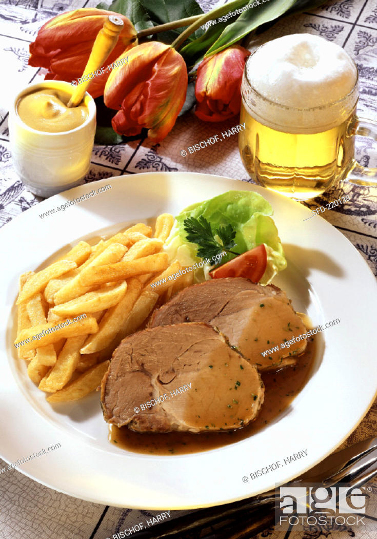 Stock Photo: Roast pork with beer sauce, chips, mustard and beer.