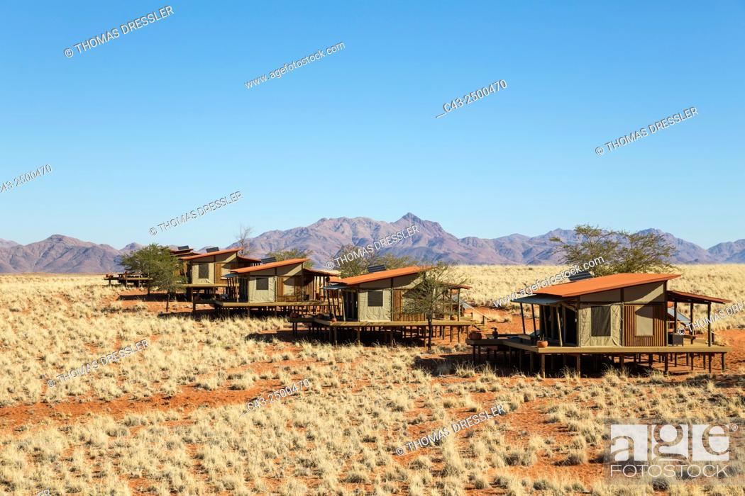 Stock Photo: The chalets of the exclusive Wolwedans dunes lodge in a beautiful desert setting at the edge of the Namib Desert. NamibRand Nature Reserve, Namibia.