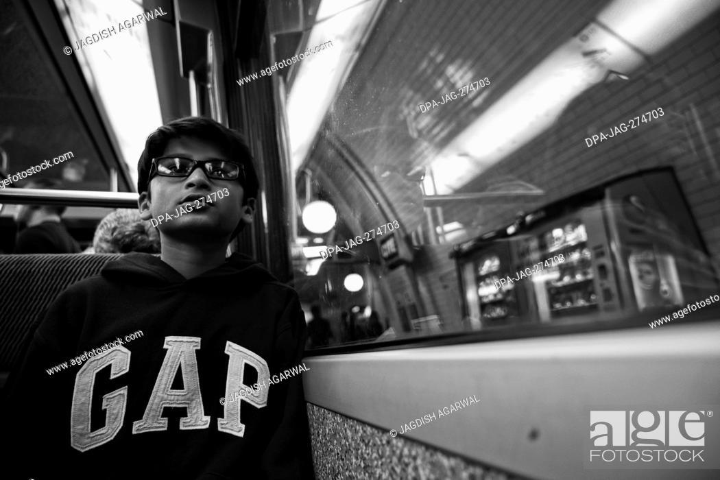 Stock Photo: Boy in metro train, Paris, France, Europe.