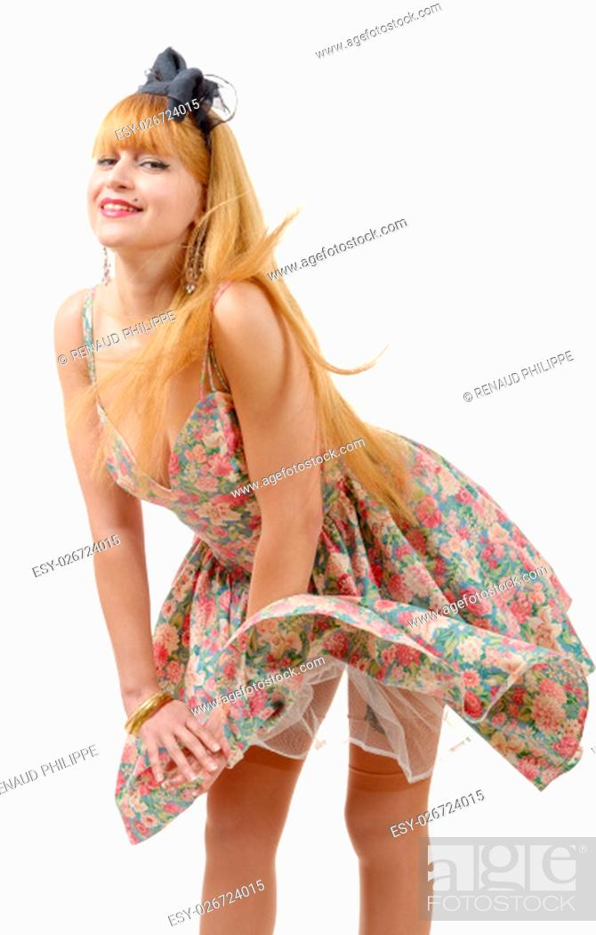 Stock Photo: Young woman in retro floral dress, isolated on white background.
