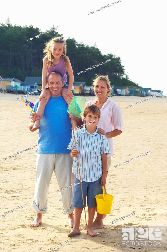 Stock Photo: Vacationing Family standing on Beach portrait.