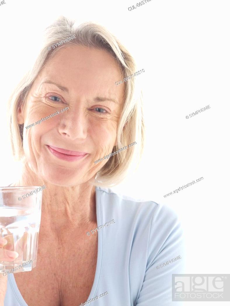 Stock Photo: Mature woman drinking water.