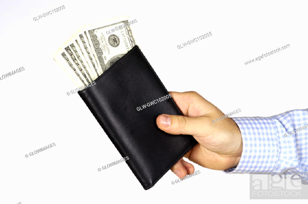 Stock Photo: Close-up of a person's hand holding a wallet.