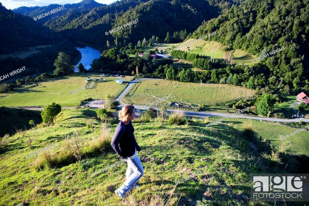Stock Photo: A Young Woman Admiring The View Overlooking Blue Duck Valley At Blue Duck Lodge, In Whanganui National Park; Whakahoro, New Zealand.