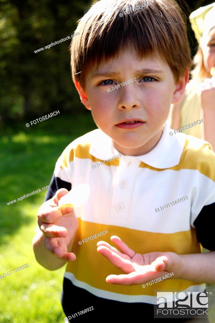 Stock Photo: Children eating potato chips.