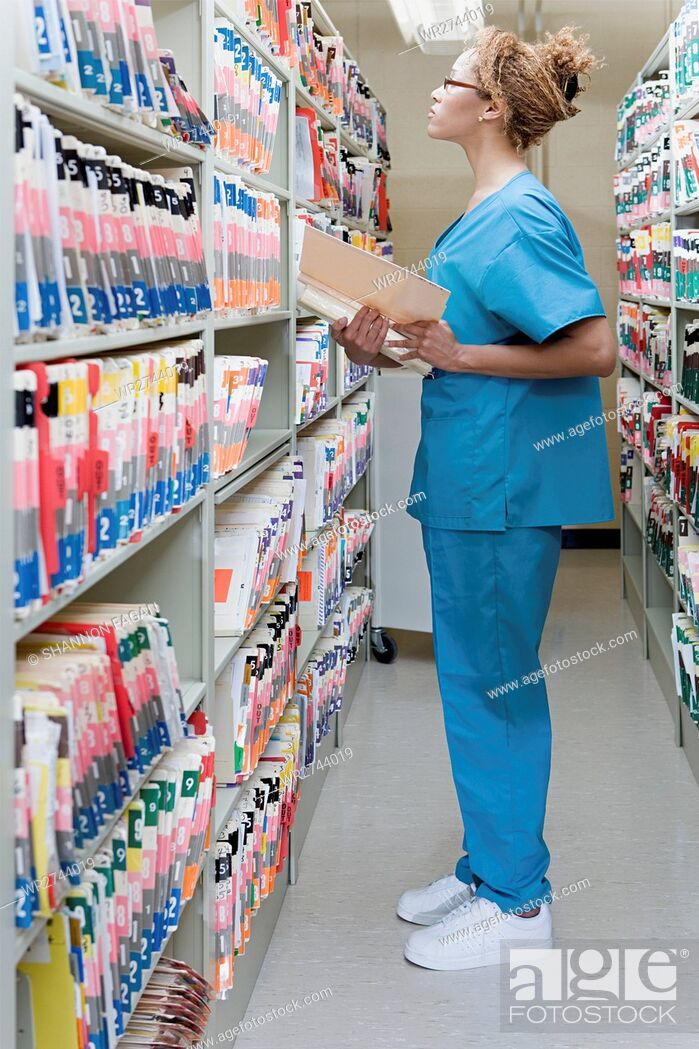Stock Photo: Hospital orderly in archives.