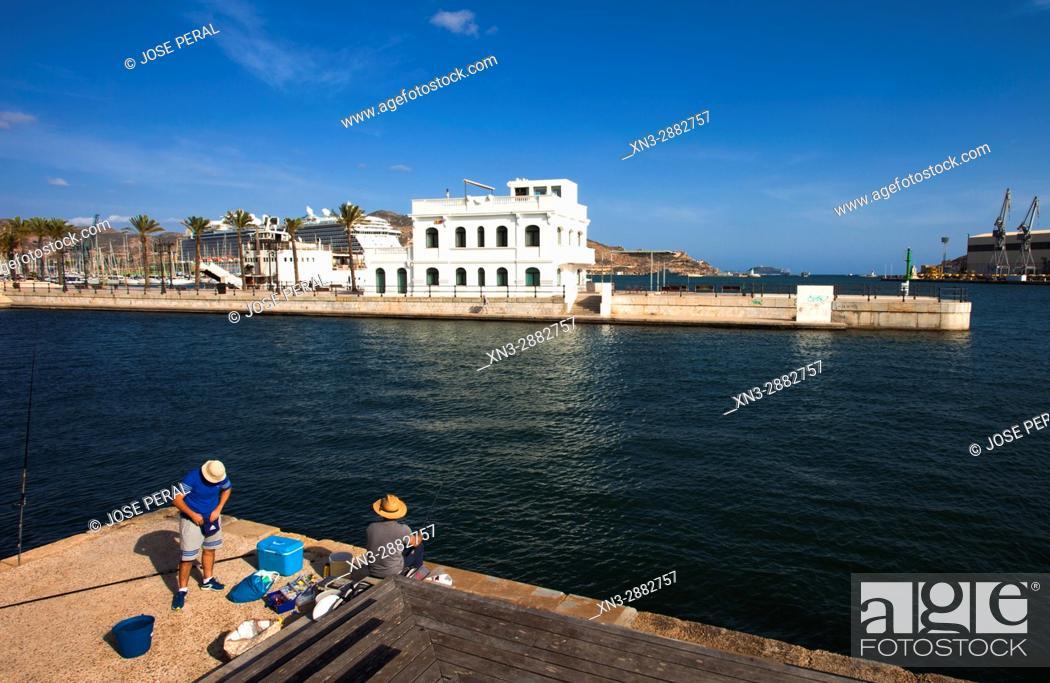Stock Photo: Fishermen, on Background Old building of the Racing Club, Antiguo edificio del Real Club de Regatas, Promenade, Mediterranean Sea, Cartagena City, Murcia Region.