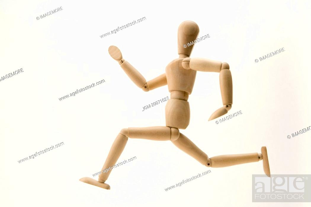 Stock Photo: A wooden figure with the gesture of running.