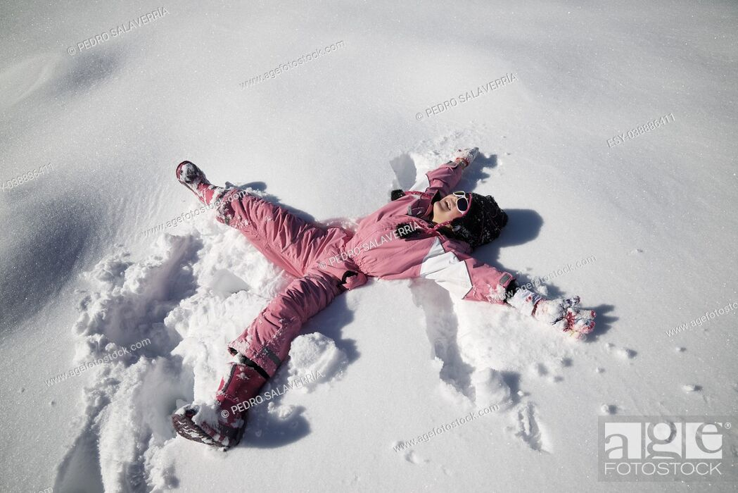 Stock Photo: Little girl playing in the snow, Pyrenees, Spain.