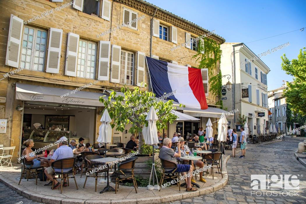 Stock Photo: Small french village cafes with French flag in Provence region of Southern France.