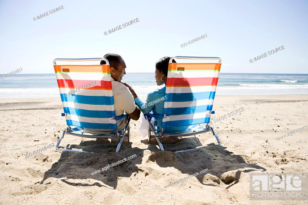 Stock Photo: Couple relaxing on a beach.