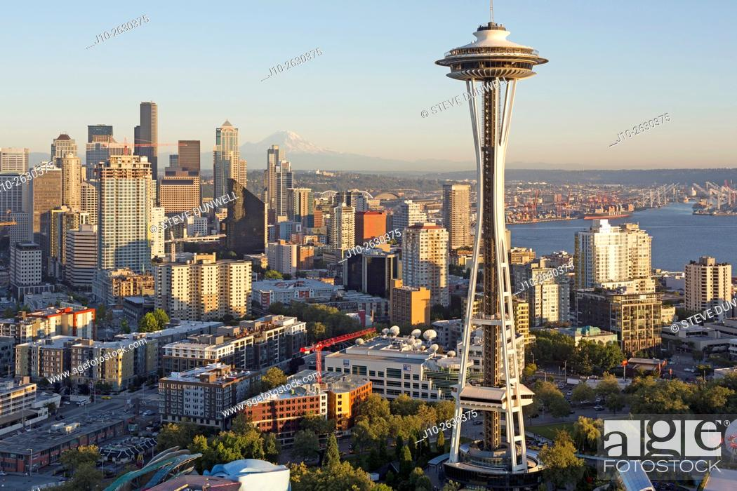 Stock Photo: Space Needle skyline aerial, Seattle, WA with Mt. Rainier, USA.