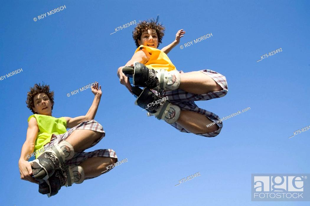 Stock Photo: Twin rollerbladers.