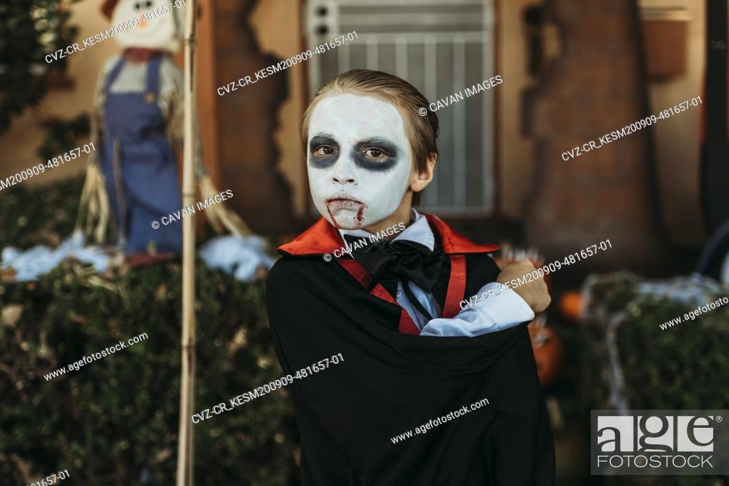 Stock Photo: Close up of boy dressed as Dracula posing in costume at Halloween.