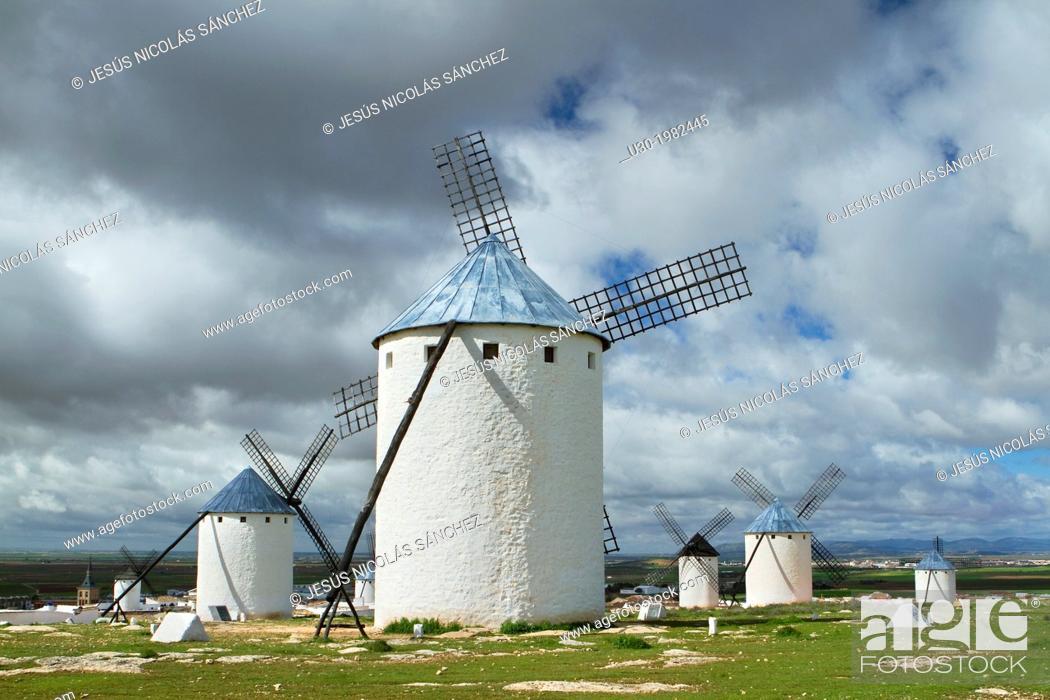 Stock Photo: Typical windmills in Campo de Criptana village, in the Route of Don Qiuijote, Ciudad Real province, Castilla-La Mancha, Spain.