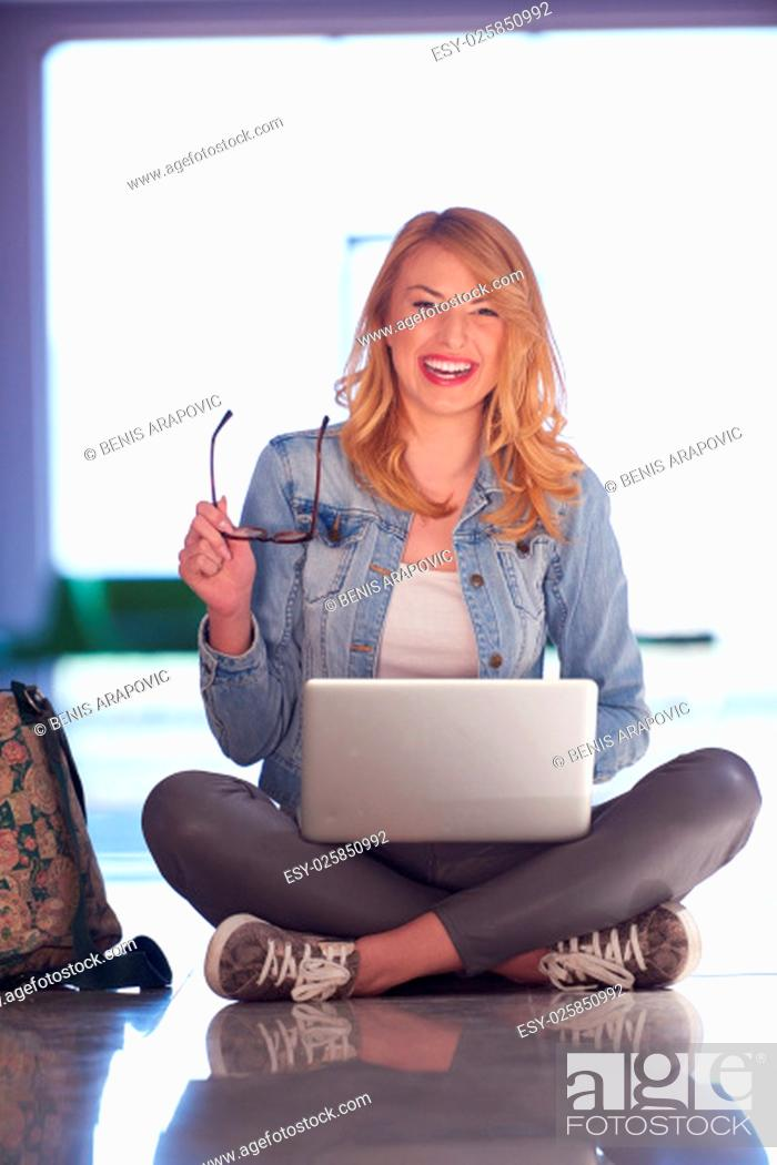 Stock Photo: happy student girl working on laptop computer at modern school university indoors.