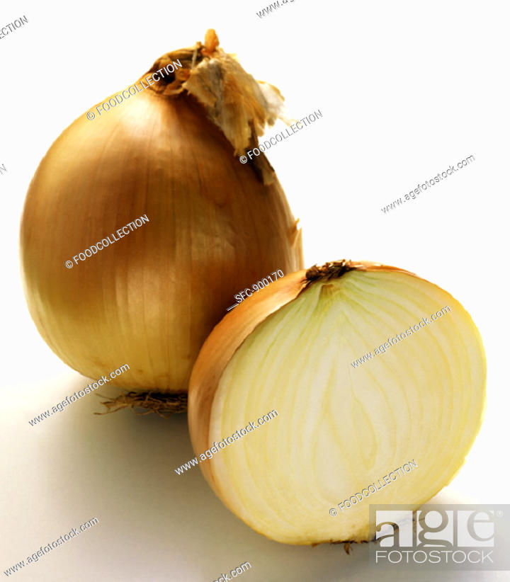 Stock Photo: A Whole and Half Yellow Onion.