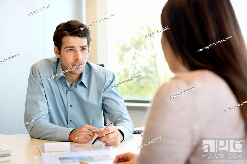 Stock Photo: Business executive discussing with his client.